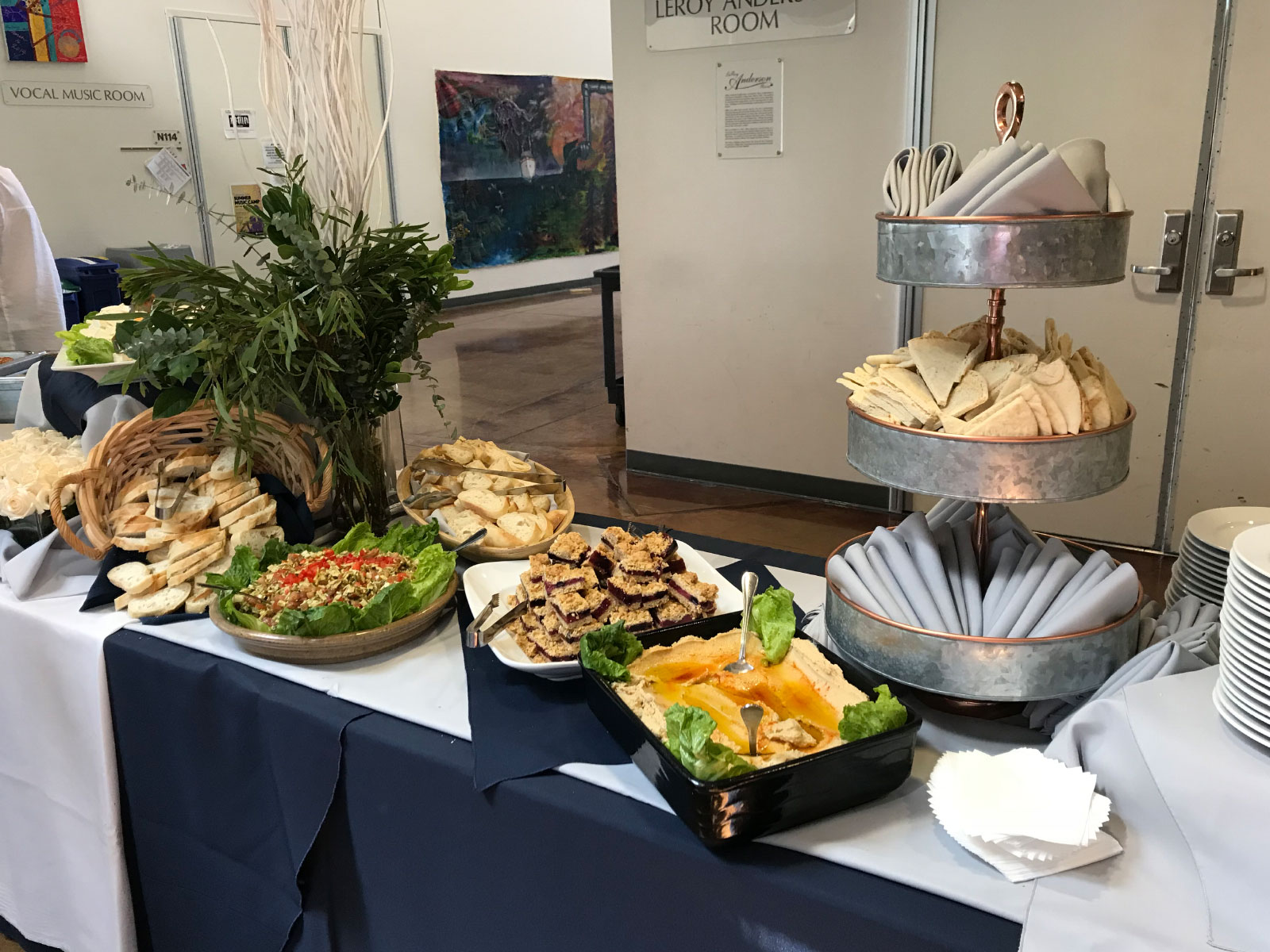 Catered food of salad, brownies, pita bread and sliced peppers at the Oregon City campus