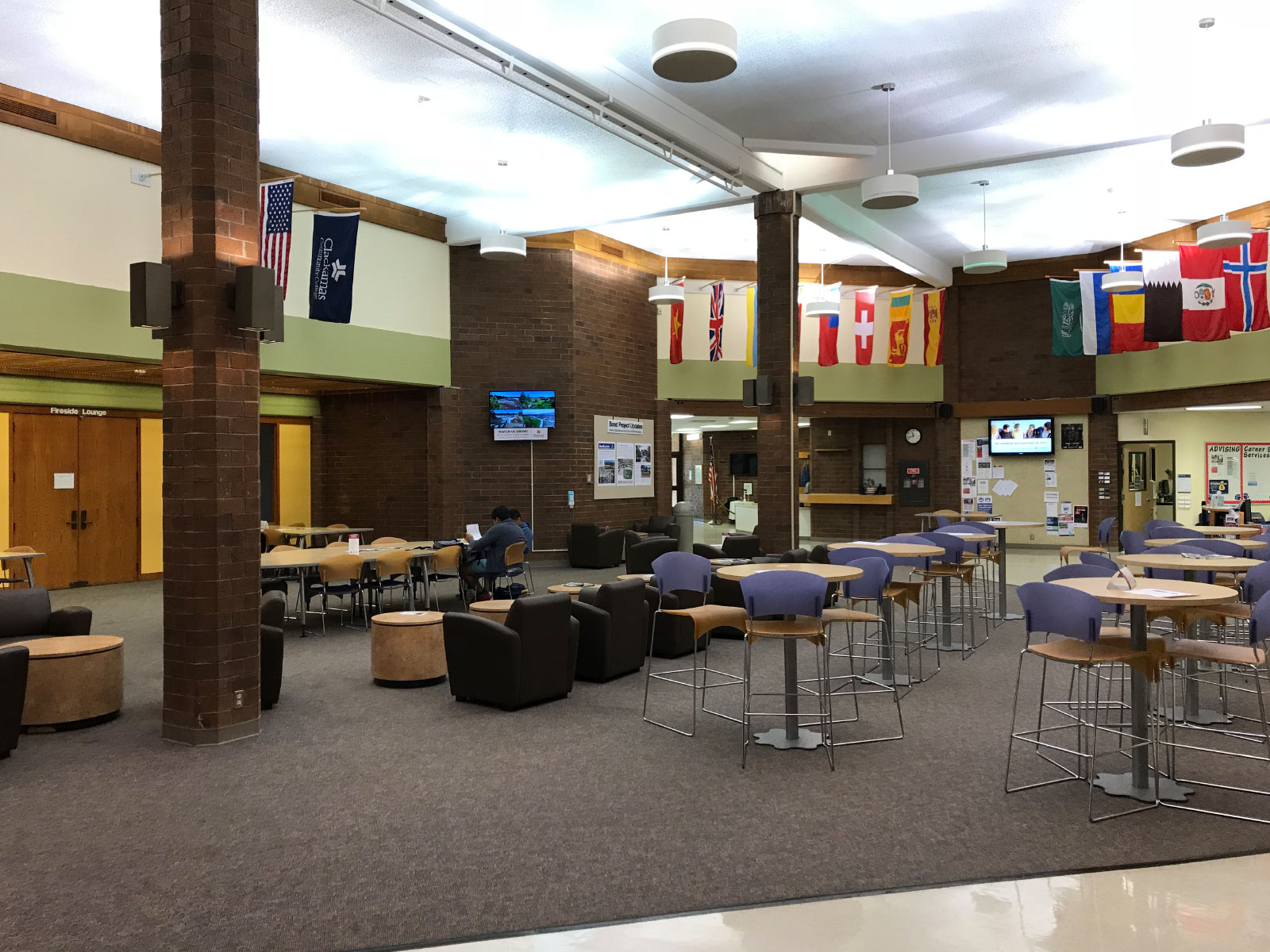 The wide interior with chairs, tables, displays and flags in the Bill Brod Community Center Mall at the Oregon City campus