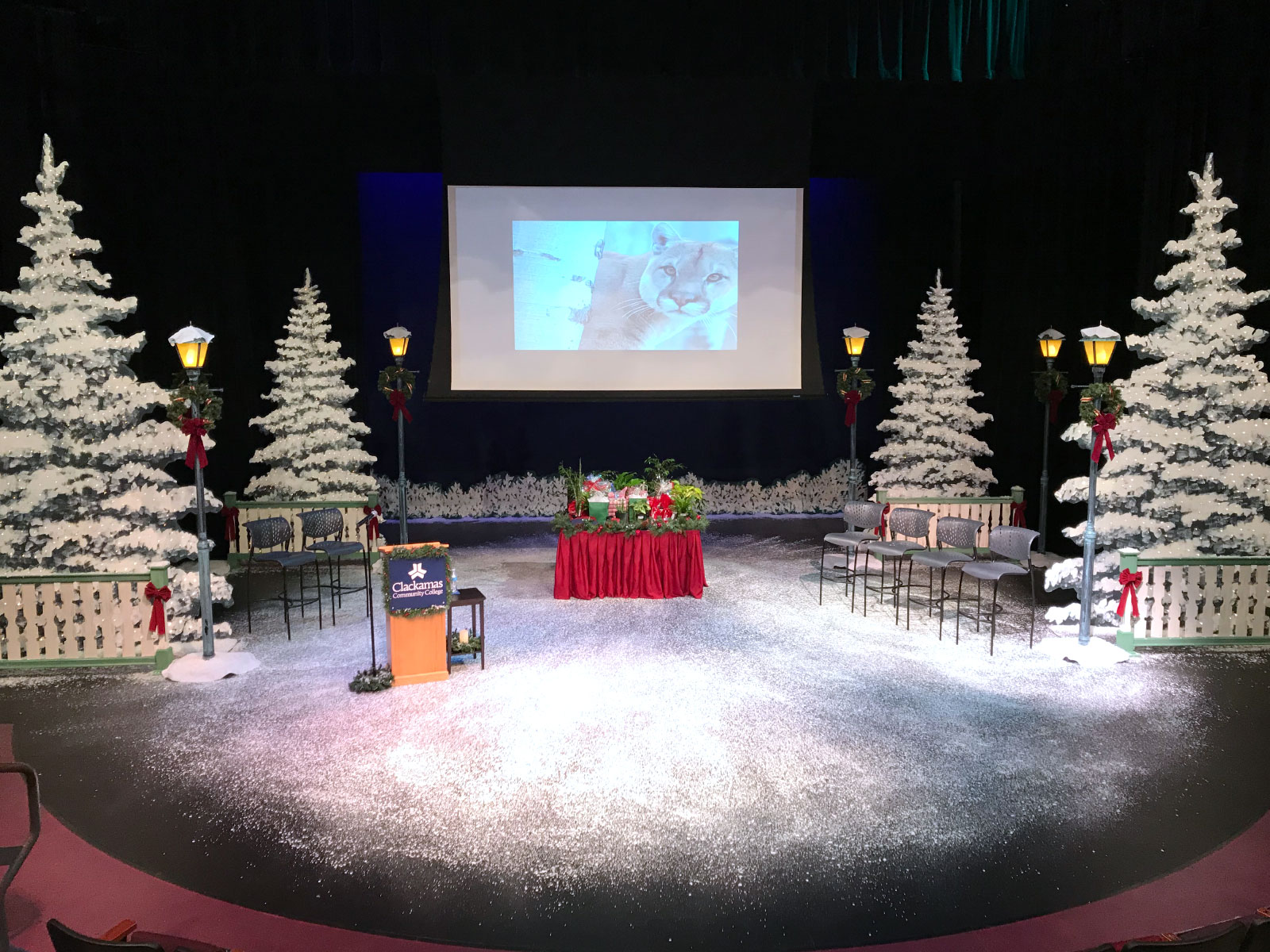 The McLoughlin theater decorated for Christmas, with snow, trees, podium and display in Niemeyer Center