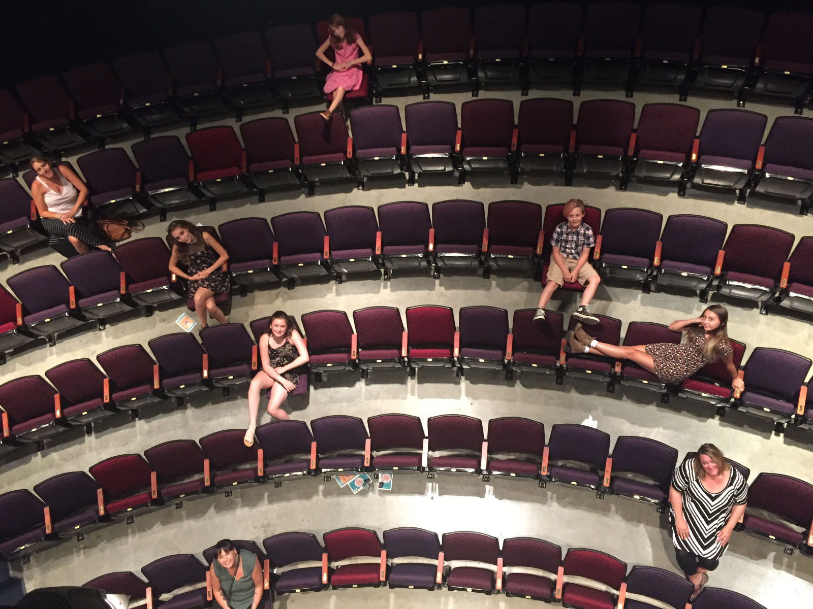 Overhead view of theatre students sitting in auditorium seats in a theater in the Oregon CIty campus